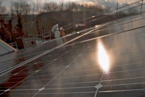 Sunlight on a rooftop solar panel